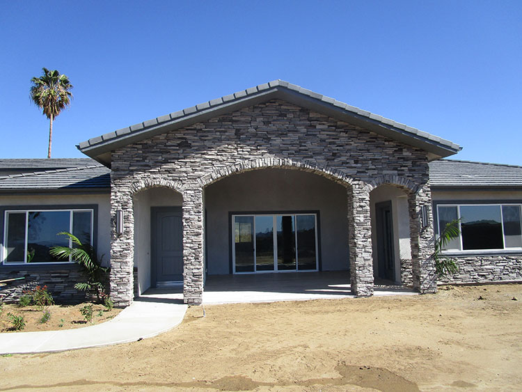 Stone veneer on the front of new custom home in Murrieta