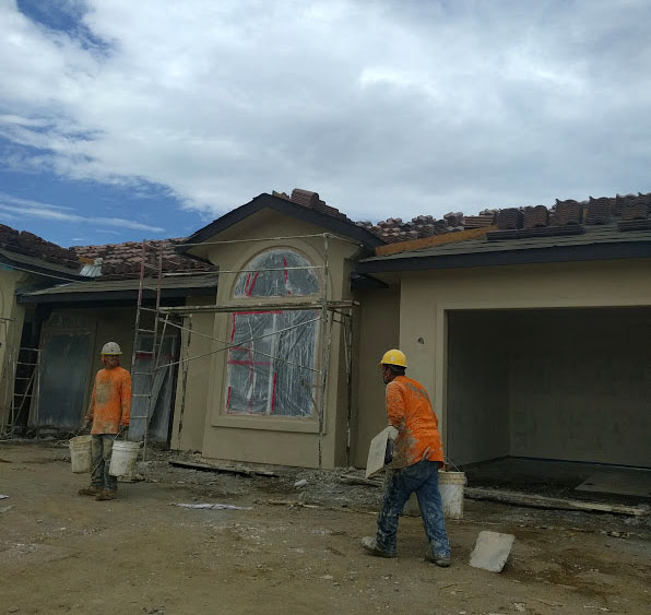 Placing stucco on a new custom home in Temecula