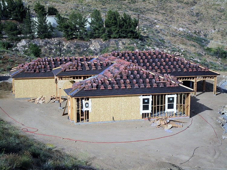 Roofing a new custom home in the hills of Tenaja