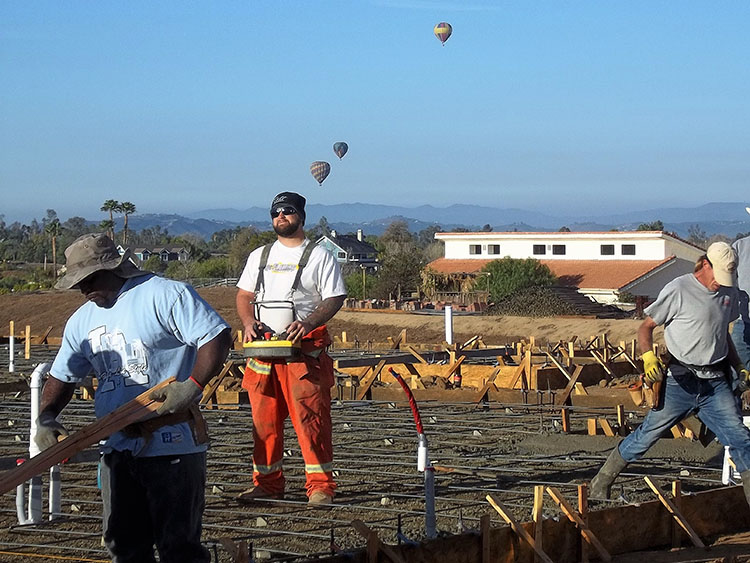 Pump truck operator, pouring new custom home foundation in Temecula